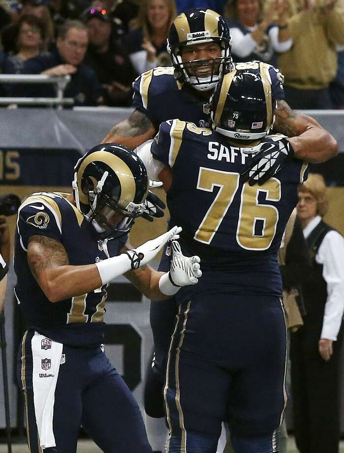 St. Louis Rams tight end Lance Kendricks, top, is congratulated by teammates Rodger Saffold (76) and Stedman Bailey after catching a 4-yard touchdown pass during the first quarter of an NFL football game against the New Orleans Saints, Sunday, Dec. 15, 2013, in St. Louis. (AP Photo/Charles Rex Arbogast) Photo: Charles Rex Arbogast, Associated Press