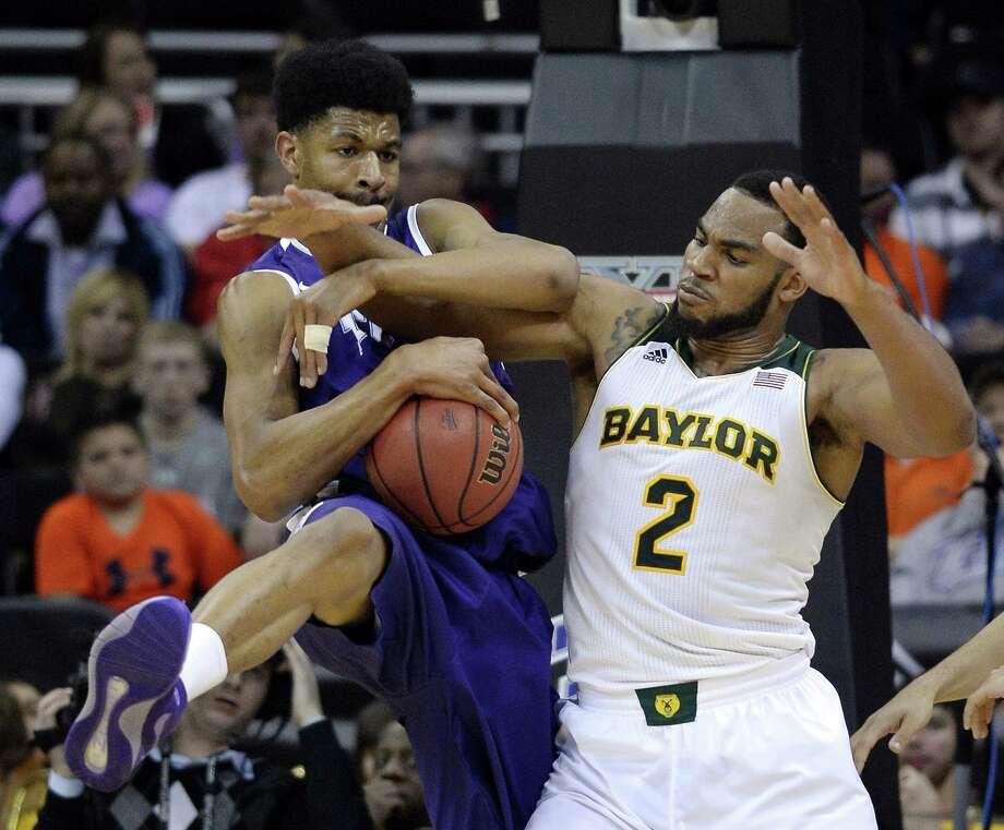 TCU's Karviar Shepherd, left, battles Baylor's Rico Gathers for a rebound. Photo: JOHN SLEEZER, MBR / Kansas City Star