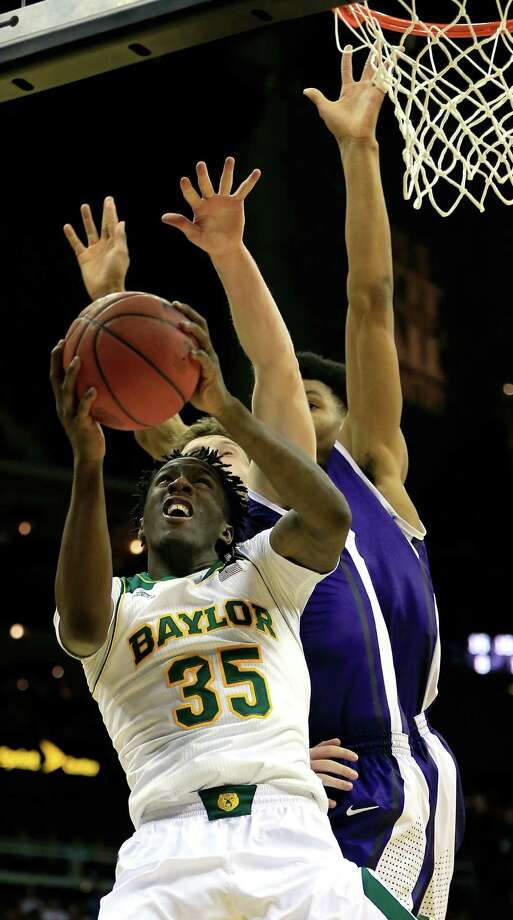 Warren High product Taurean Waller-Prince takes a shot for Baylor during the Bears' first-round win over TCU. Photo: Jamie Squire / Getty Images / 2014 Getty Images