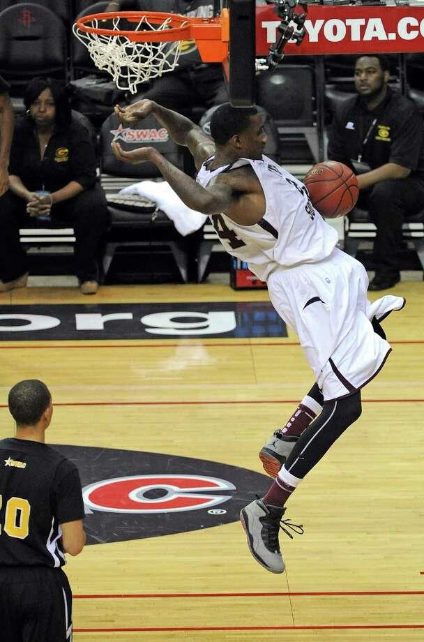 TSU's Aaric Murray, who had 18 points, follows through on a dunk. Photo: Eric Christian Smith, Freelance