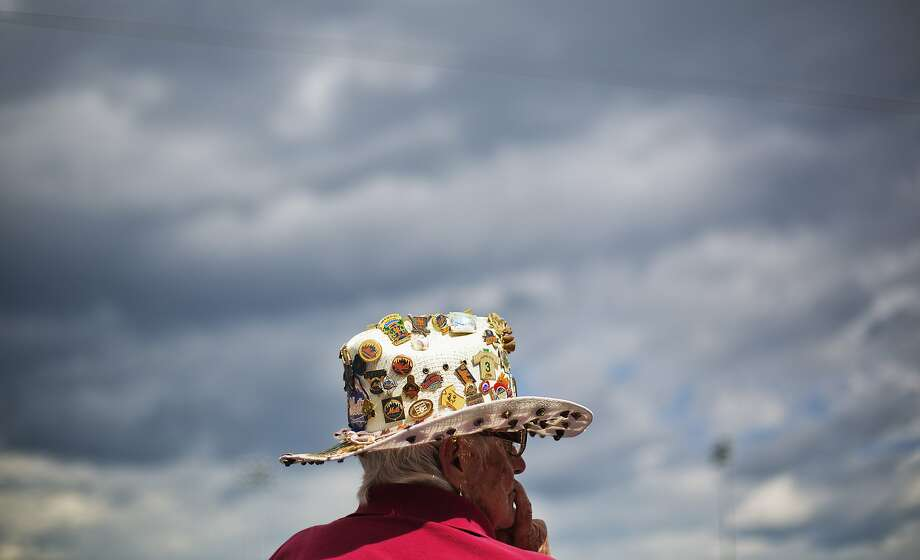 New York Mets fan Pat Lowe, 83, of Port St. Lucie, Fla., watches an exhibition spring training baseball game between the Mets and the St. Louis Cardinals, Wednesday, March 12, 2014, in Port St. Lucie, Fla. (AP Photo/David Goldman) Photo: David Goldman, Associated Press