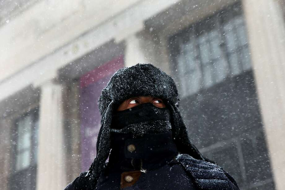 Rashid Johnson of Rochester, waits for his bus during a snow storm, Wednesday, March 12, 2014 in Rochester, N.Y. Many business and government offices closed early ahead of a winter storm. (AP Photo/Democrat & Chronicle, Max Schulte)  MAGS OUT; NO SALES Photo: Max Schulte, Associated Press