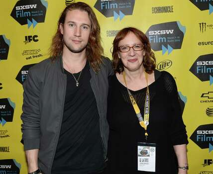 "AUSTIN, TX - MARCH 12:  Director Christian Larson (L) and Janet Pierson, SXSW Film Festival Director pose for pictures in the green room for the screening of ""Leave the World Behind"" at Paramount Theatre on March 12, 2014 in Austin, Texas. Photo: Michael Buckner, Getty Images / 2014 Getty Images"