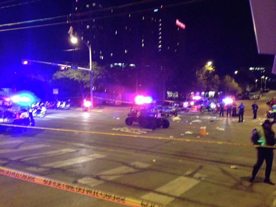 A photo of the aftermath at 10th and Red River in Austin, Texas, after a suspected drunk driver barreled through a police barricade and into a crowded street. Two were killed, 23 were injured, five critically, in the incident. Photo: Nolan Hicks/Express-News