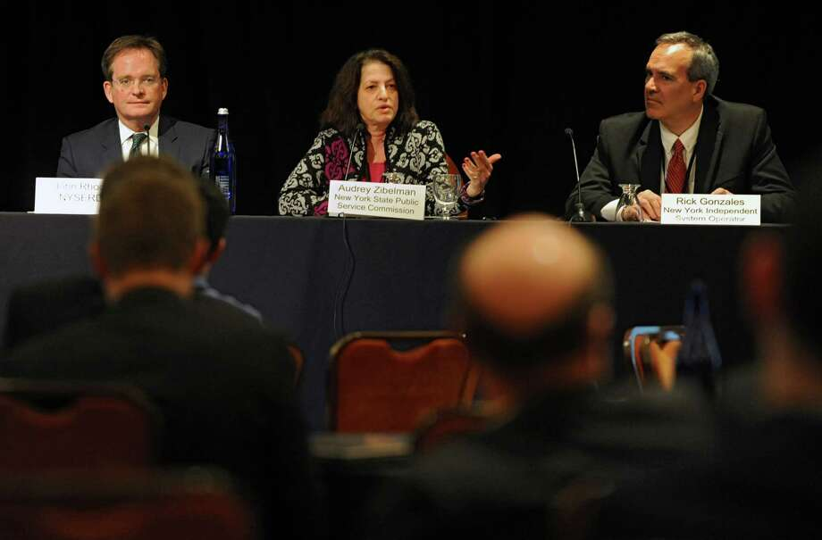 Audrey Zibelman, chair of PSC, center, speaks about the future of state energy policy and renewable energy at the Hilton Garden Inn on Wednesday, March 12, 2014 in Troy, N.Y. NYSERDA CEO John Rhodes, left, and Rick Gonzalas, New York Independent System Operator exececutive, were also on the panel.  (Lori Van Buren / Times Union) Photo: Lori Van Buren / 00026116A