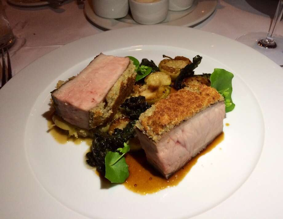 Mustard-crusted pork loin with braised cabbage, lollipop kale and tiny roasted apples ($28)