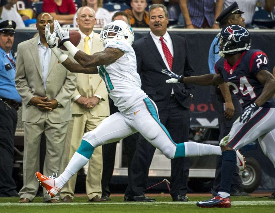 Wide receiver  Mike Wallace  Miami Dolphins  Base salary: $15 million Photo: Smiley N. Pool, Houston Chronicle