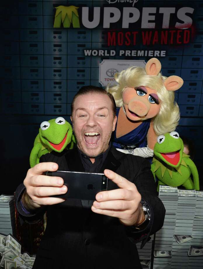 "Ricky Gervias, Miss Piggy and Kermit arrive for the premiere of Disney's ""Muppets Most Wanted"" at the El Capitan Theatre on March 11, 2014 in Hollywood, California. Photo: Kevin Winter, Getty Images / 2014 Getty Images"