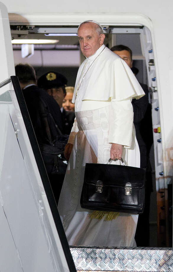 Pope Francis looks back before boarding a plane after his week-long visit to Brazil to celebrate World Youth Day, at the airport in Rio de Janeiro, Brazil, Sunday, July 28, 2013. The trip marked the first international foray for the Argentine-born pontiff and his first voyage back to his home continent since becoming pope in March.  Photo: Andre Penner, ASSOCIATED PRESS / AP2013
