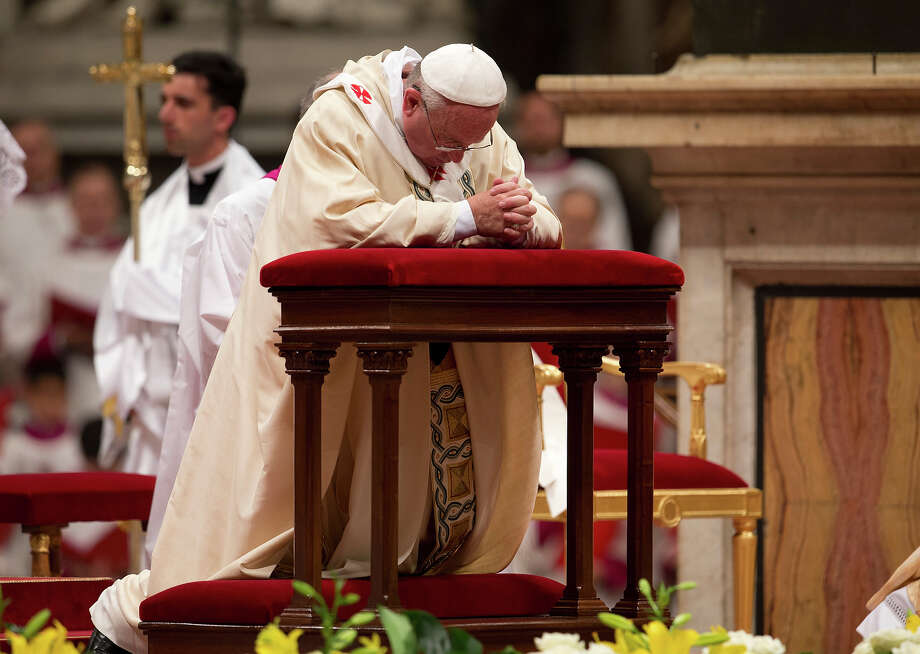 Pope Francis prays as he celebrates a ceremony to ordain new bishops, in St. Peter's Basilica, at the Vatican, Thursday, Oct. 24, 2013. The pontiff ordained two new bishops during the ceremony. Photo: Andrew Medichini, AP / AP