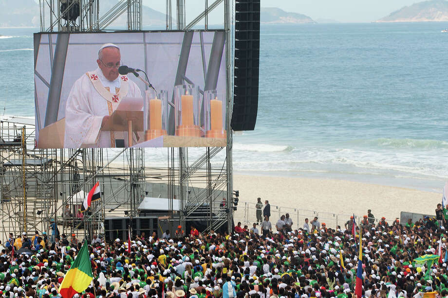 Pope Francis is seen on a large screen as he celebrates the World Youth Day's concluding Mass on Copacabana beach, in Rio de Janeiro, Brazil, Sunday, July 28, 2013.  Photo: Victor R. Caivano, ASSOCIATED PRESS / AP2013