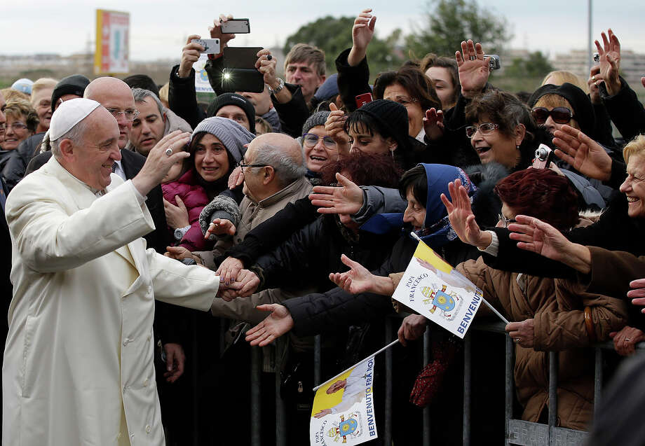 Pope Francis is cheered by faithful upon his arrival at the Parish Church of St. Cirillo Alessandrino, in Rome, Sunday, Dec. 1, 2013. Photo: Gregorio Borgia, AP / AP2013