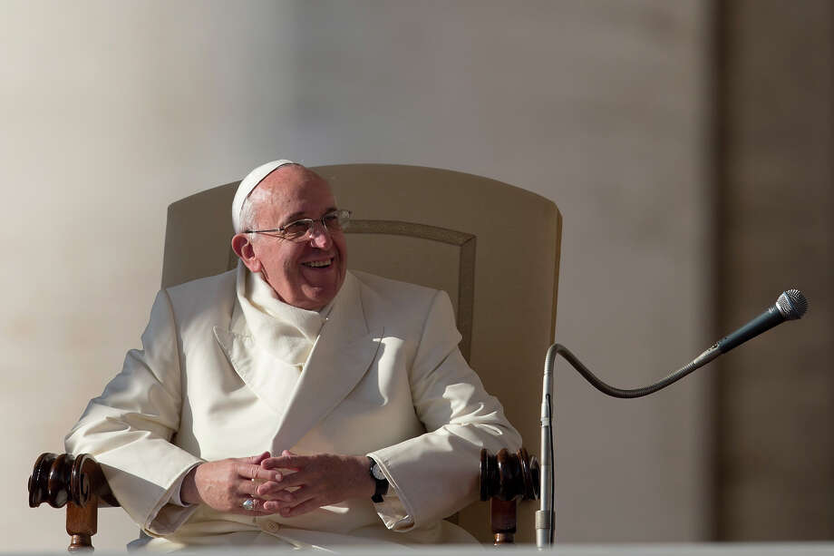 Pope Francis smiles during his weekly general audience in St. Peter's Square at the Vatican, Wednesday, Dec. 11, 2013. Photo: Alessandra Tarantino, AP / AP