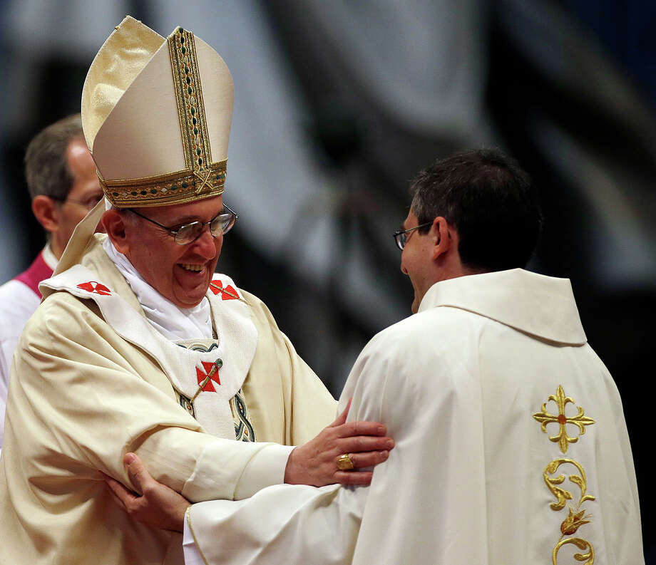 Pope Francis hugs a newly ordained priest during a ceremony in St. Peter's Basilica at the Vatican, Sunday, April 21, 2013. Photo: Gregorio Borgia, AP / AP