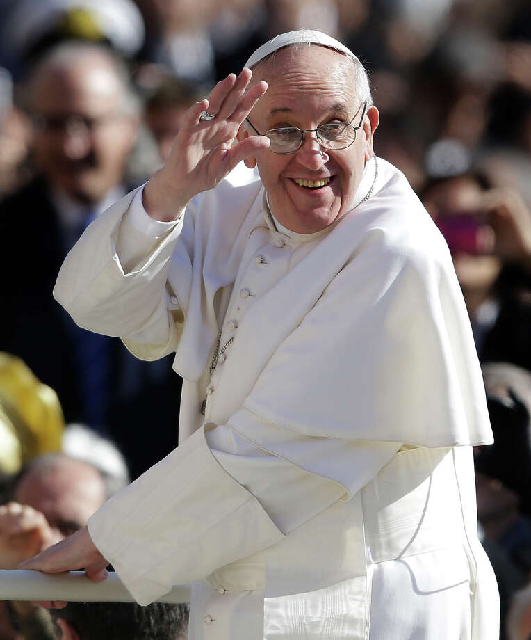 Pope Francis waves to crowds as he arrives to his inauguration Mass in St. Peter's Square at the Vatican, Tuesday, March 19, 2013. Photo: Gregorio Borgia, ASSOCIATED PRESS / AP2013