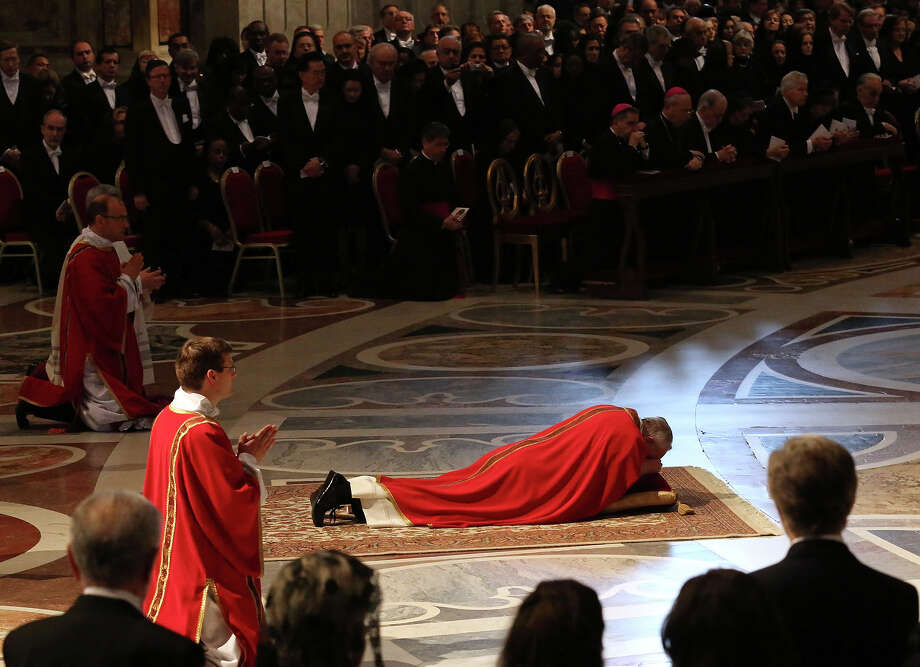 Pope Francis lies down in prayer during the Passion of Christ Mass inside St. Peter's Basilica, at the Vatican, Friday, March 29, 2013. Pope Francis began the Good Friday service at the Vatican with the Passion of Christ Mass and hours later will go to the ancient Colosseum in Rome for the traditional Way of the Cross procession.  Photo: Gregorio Borgia, ASSOCIATED PRESS / AP2013
