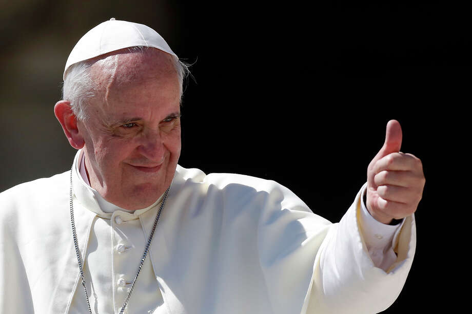 Pope Francis gives his thumb up as he leaves at the end of his weekly general audience in St. Peter's square at the Vatican, Wednesday, Sept. 4, 2013. Photo: Riccardo De Luca, AP / AP