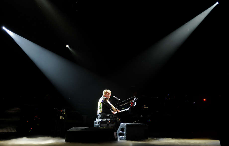 "Sir Elton John opens Wednesday night's performance with ""Funeral for a Friend"" at the piano. John performed at the Ford Park Arena on Wednesday night.