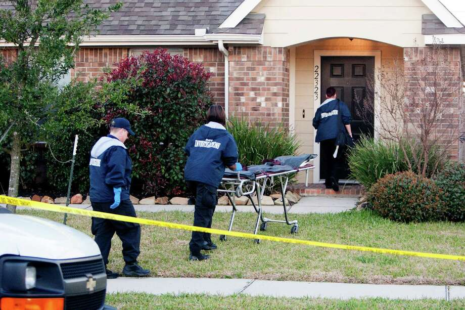 Authorities investigate the shooting of a teen at a home in the 22300 block of Bridgestone Ridge, Thursday, March 13, 2014, in Houston. The shooing happened about 2:30 a.m. on Bridgestone Ridge near FM 2920 after a man found a a 17-year-old male in his daughter's bedroom. There was a struggle and the teen was shot. Photo: Cody Duty, Houston Chronicle / © 2014 Houston Chronicle