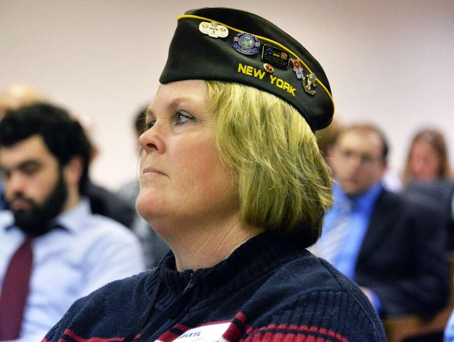 US Army veteran of Operation Enduring Freedom, Beth Jarrett of Clifton Park listens to the announcement of a new statewide expansion to the Rapid Response Referral Program to help new veterans and their families cut through red tape and provides them with access to services ranging across employment, education, housing, mental health and more at the LOB Wednesday March 12, 2014, in Albany, NY.  (John Carl D'Annibale / Times Union) Photo: Albany Times Union