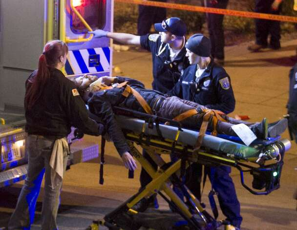 A man is transported to an ambulance after being struck by a vehicle on Red River Street in downtown Austin, Texas, on Wednesday March 12, 2014. Police say two people were confirmed dead at the scene after a car drove through temporary barricades set up for the South By Southwest festival and struck a crowd of pedestrians. The condition of the man is unknown. Photo: Jay Janner, Associated Press