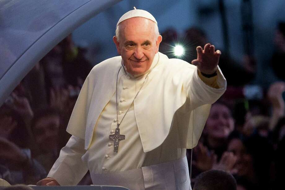 Pope Francis waves from the Popemobile on his way to attend the Via Crucis on Copacabana Beach during World Youth Day celebrations on July 26, 2013 in Rio de Janeiro, Brazil. Photo: Buda Mendes, Getty Images / 2013 Getty Images