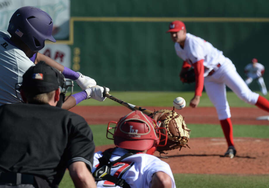 Lamar's Travis Moore leans into a pitch against Prairie View A&M at Vincent Beck on Wednesday. Photo taken Wednesday, March 12, 2014 Guiseppe Barranco/@spotnewsshooter Photo: Guiseppe Barranco, Photo Editor