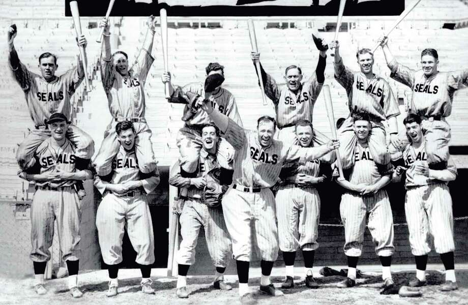 1935: Why are these players excited? The mighty Seals, with Lefty O'Doul (center) and Joe DiMaggio (lower right) had just won the Pacific Coast League title. Photo: None, Chronicle File / Chronicle