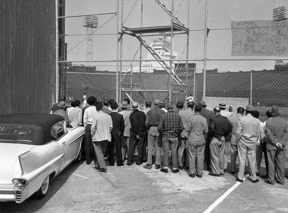April 8, 1958: Shades of the right field wall at AT&T Park. Curious fans on 16th Street watch the Giants' first practice in their new home. Photo: Art Frisch, The Chronicle