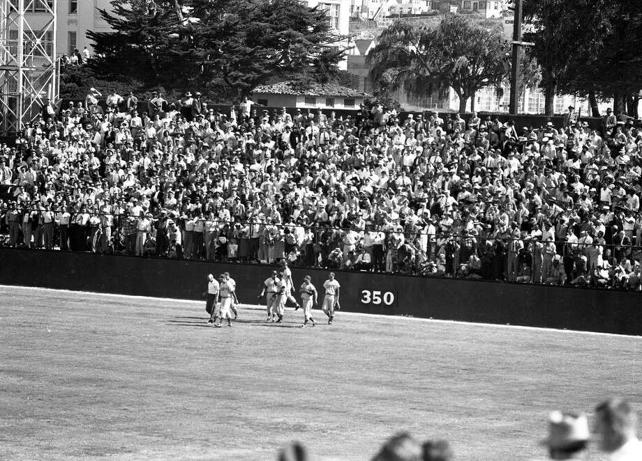 April 15, 1958: The San Francisco Giants runs out on the field for the first time. These bleachers were backed up against 16th Street. That's Franklin Square in the background. Photo: Bob Campbell, The Chronicle