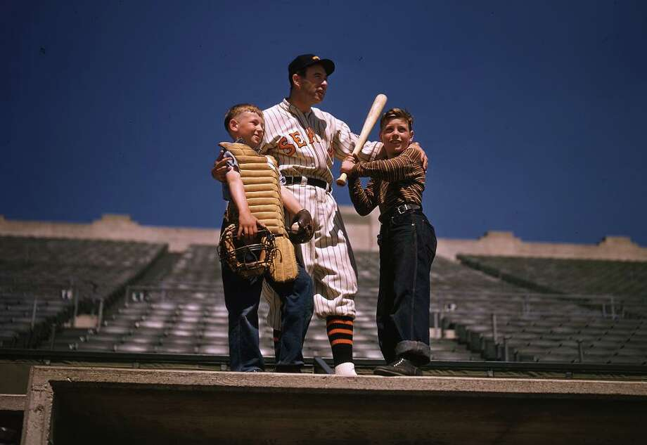 1939: Bonus Lefty! We have almost no color photos in the archives before the 1990s, but by some crazy accident/divine intervention we have this Lefty O'Doul photo, hanging out on the home dugout of Seals Stadium with adoring fans. Photo: Chronicle File
