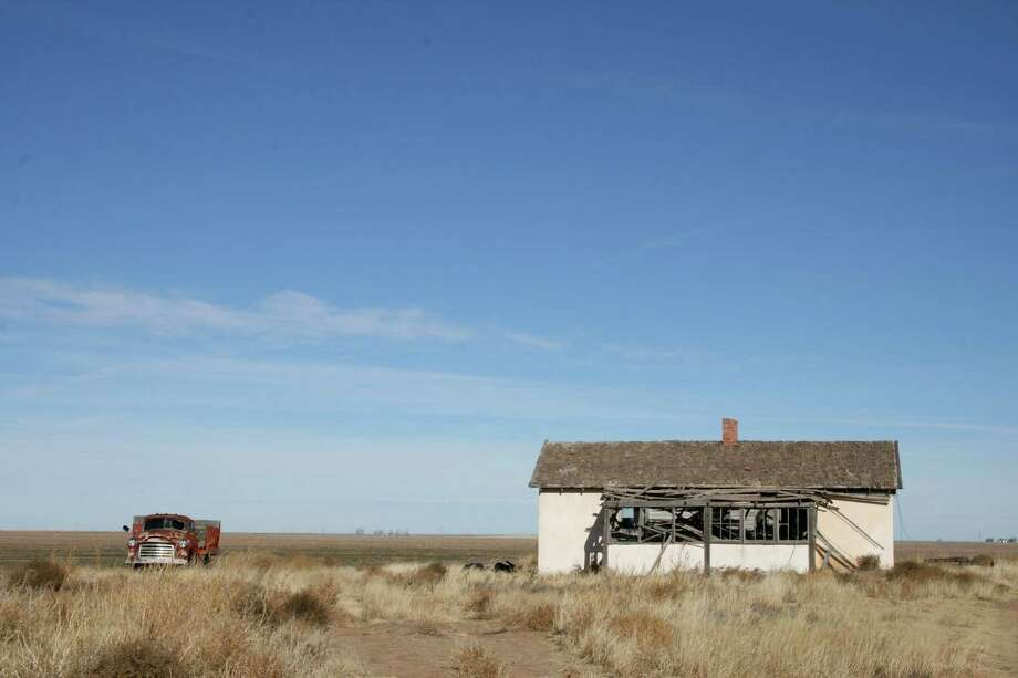 An abandoned building and car are reminders of the past in rural Cimarron County in Oklahoma's Panhandle. Photo: Kristi Eaton, STF / AP