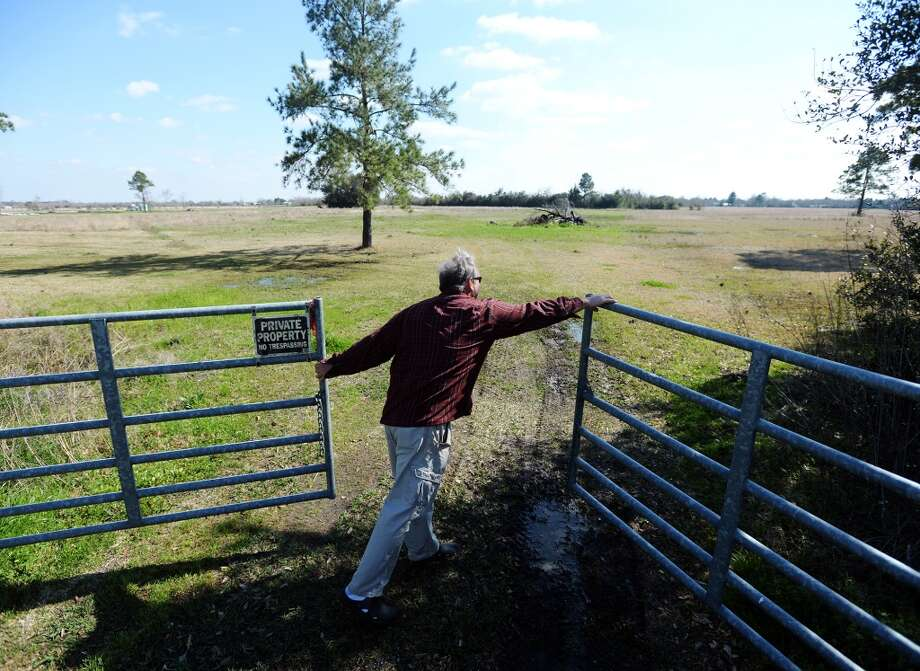 Steve Heironimus closes the gate to property where he and his wife grow produce for sale at farmers' markets. Donna and Steve Heironimus run Donna's Farm, a naturally certified farm that will be selling produce at this year's Beaumont Farmer's Market. Photo taken Thursday, 3/6/14 Jake Daniels/@JakeD_in_SETX