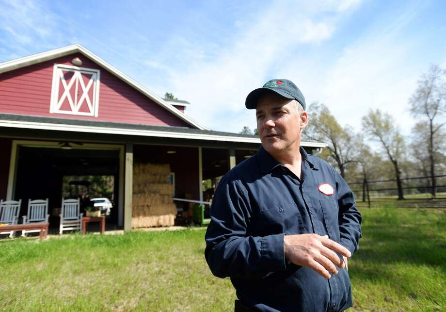 Steve Socher talks about his experience running a farm and selling produce Friday afternoon. Socher spends his days as a Beaumont urologist but his downtime tending to Back 40 Farms, where he grows vegetables. Photo taken Friday, 3/7/14 Jake Daniels/@JakeD_in_SETX