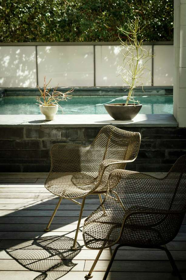 Patio chairs inherited from her mother sit in the backyard in Lynn Goode's contemporary Highland Village-area home. Photo: Michael Paulsen, Staff / © 2014 Houston Chronicle