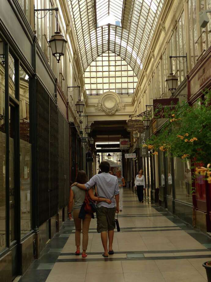 Locals stroll through Passage du Grand Cerf, one of the remaining covered passages in Paris. Photo: Spud Hilton / ONLINE_YES