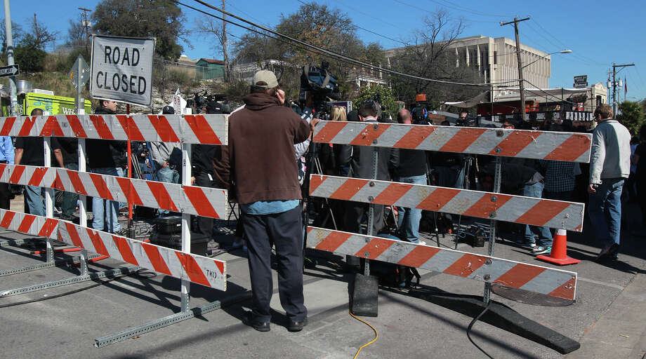 This is the corner of 9th and Red River in downtown  where a a motorist crashed through barriers that resulted in two deaths and more than 20 people being injured after a man in a car attempted to evade police at about 12:30 a.m. The driver of the vehicle sped down a barricaded portion Red River street where the South by Southwest Music Festival was taking place and hit more than 20 people in his car. A cyclist from the Netherlands was killed and a female riding on a moped was killed. The suspect, a black adult male, was tazed and apprehended and will face capital murder charges. Photo: JOHN DAVENPORT, SAN ANTONIO EXPRESS-NEWS / ©San Antonio Express-News/Photo may be sold to the public