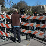 This is the corner of 9th and Red River in downtown  where a a motorist crashed through barriers that resulted in two deaths and more than 20 people being injured after a man in a car attempted to evade police at about 12:30 a.m. The driver of the vehicle sped down a barricaded portion Red River street where the South by Southwest Music Festival was taking place and hit more than 20 people in his car. A cyclist from the Netherlands was killed and a female riding on a moped was killed. The suspect, a black adult male, was tazed and apprehended and will face capital murder charges.