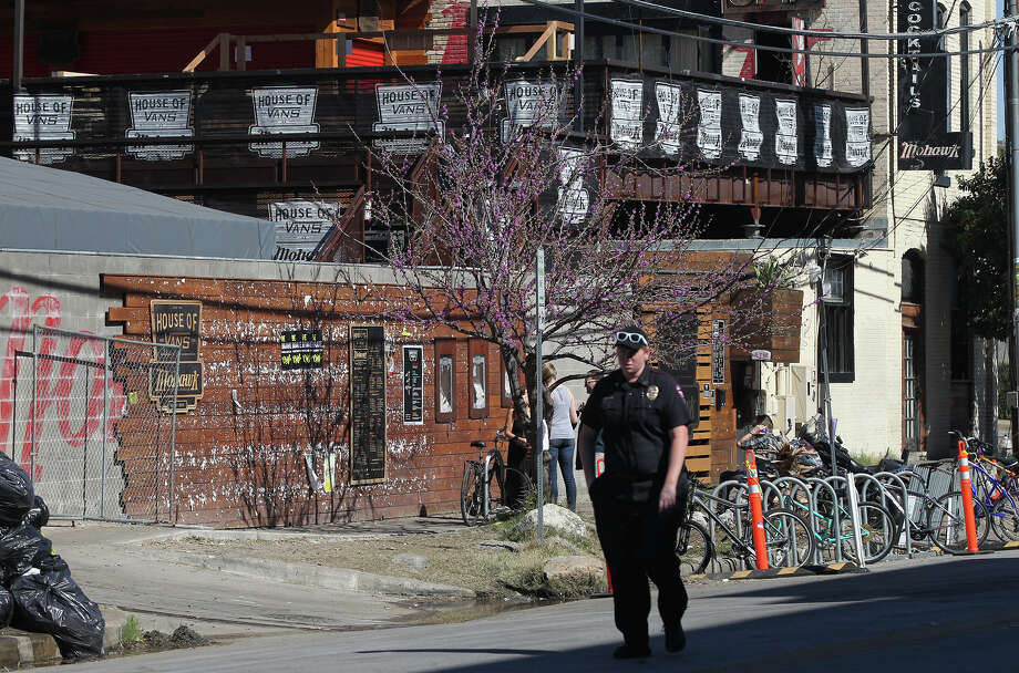 This is the Mowhawk night club on Red River street in downtown where a a motorist crashed through barriers that resulted in two deaths and more than 20 people being injured after a man in a car attempted to evade police at about 12:30 a.m. The driver of the vehicle sped down a barricaded portion Red River street where the South by Southwest Music Festival was taking place and hit more than 20 people in his car. A cyclist from the Netherlands was killed and a female riding on a moped was killed. The suspect, a black adult male, was tazed and apprehended and will face capital murder charges. Photo: JOHN DAVENPORT, SAN ANTONIO EXPRESS-NEWS / ©San Antonio Express-News/Photo may be sold to the public