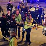 A victim is carried away after being struck by a vehicle on Red River Street in downtown Austin, Texas, during SXSW, March 12, 2014.