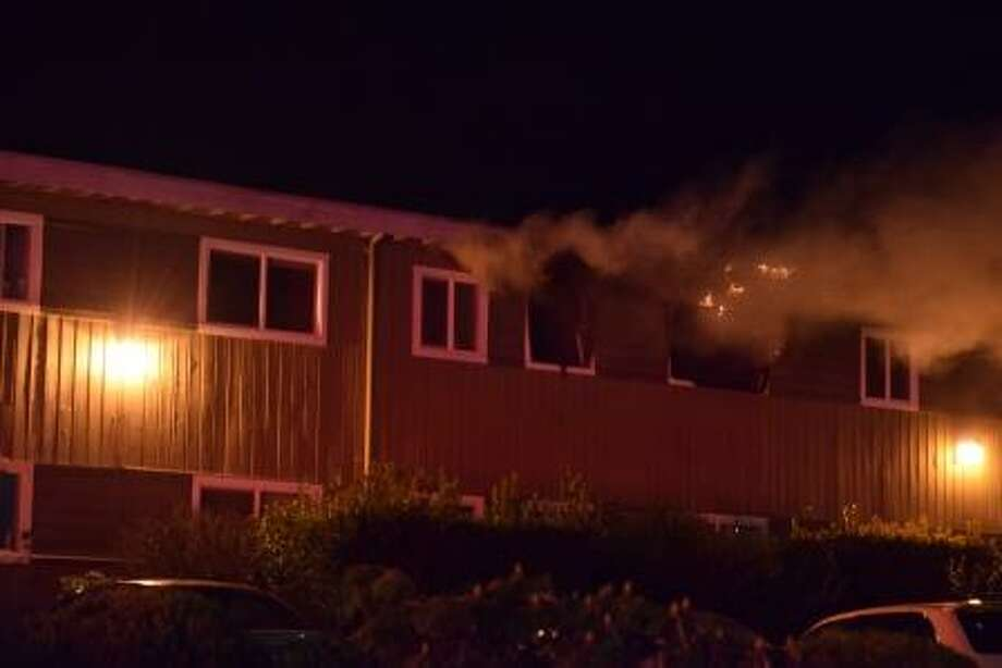 Crews tackled a SeaTac apartment fire Wednesday night that displaced four residents. The fire investigator is still working on finding the cause. Photo: Kent Fire Department
