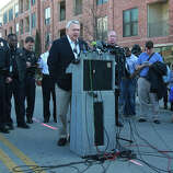Austin mayor Lee Leffingwell (center, at lectern) speaks Thursday March 13, 2014 at a press conference in downtown Austin after two people were killed and more than 20 people were injured after a man in a car attempted to evade police at about 12:30 a.m. The driver of the vehicle sped down a barricaded portion Red River street where the South by Southwest Music Festival was taking place and hit more than 20 people in his car. A cyclist from the Netherlands was killed and a female riding on a moped was killed. The suspect, a black adult male, was tazed and apprehended and will face capital murder charges.