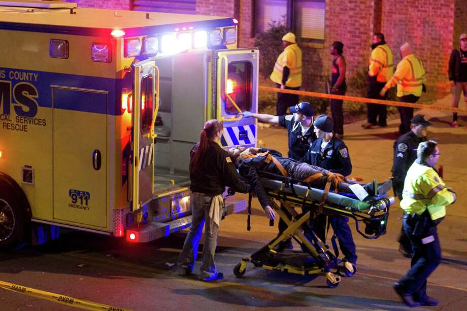 A man is transported to an ambulance after being struck by a vehicle on Red River Street in downtown Austin, Texas, during SXSW on Wednesday March 12, 2014. Police say two people were confirmed dead at the scene after a car drove through temporary barricades set up for the South By Southwest festival and struck a crowd of pedestrians. Photo: Jay Janner, AP Photo/Austin American-Statesman/Statesman.com / Austin American-Statesman