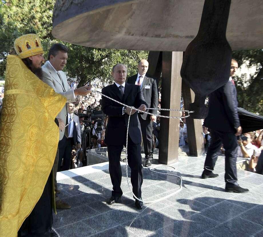 Russian President Vladimir Putin (center) and Ukrainian President Viktor Yanukovych (second from left) attend a religious service in Crimea in July. Photo: RIA Novosti, Reuters