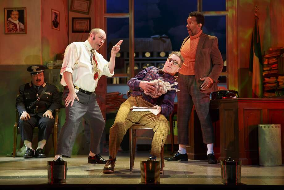 Constable (Eugene Ma, left), Police Superintendent (Liam Craig), Maniac (Steven Epp) and Inspector Pissani (Allen Gilmore) investigate. Photo: Joan Marcus