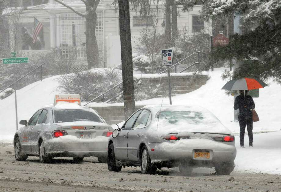 Slow-going morning commute on Western Avenue following a winter storm on Thursday March 13, 2014 in Albany, N.Y. (Michael P. Farrell/Times Union) Photo: Michael P. Farrell