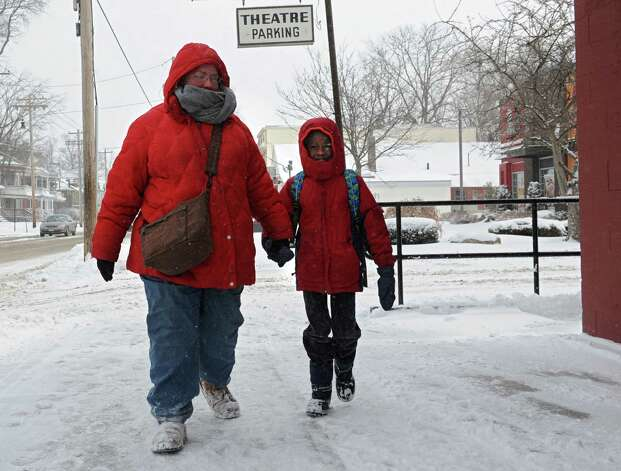 Emma Potik of Albany walks her son Zachary Potik, 7, to school along Delaware Ave. on Thursday, March 13, 2014, in Albany, N.Y.  (Lori Van Buren / Times Union) Photo: Lori Van Buren / 00026147A