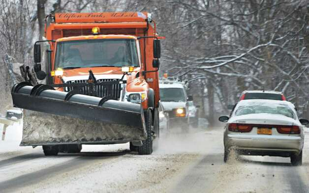 Motorists spend yet another morning commute sharing the road with a snow plow like this Clifton Park town truck Thursday March 13, 2014, in Clifton Park, NY.  (John Carl D'Annibale / Times Union) Photo: John Carl D'Annibale / 00026147A