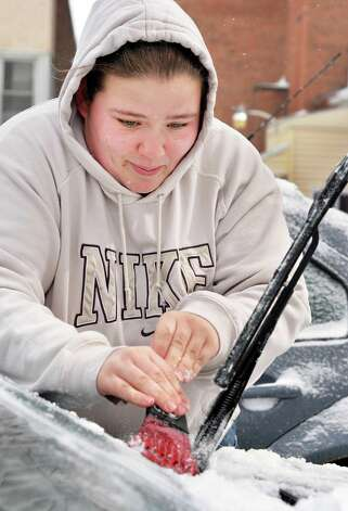 Lindsey Jackson of Cohoes chips ice from her windshield Thursday March 13, 2014, in Cohoes, NY.  (John Carl D'Annibale / Times Union) Photo: John Carl D'Annibale / 00026147A
