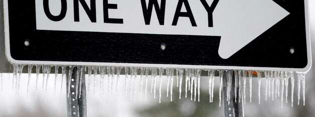 Icicles hang from a one-way sign near Central Park in Schenectady, N.Y.  Thursday, March 13, 2014. (Skip Dickstein / Times Union) Photo: SKIP DICKSTEIN / 00026147A